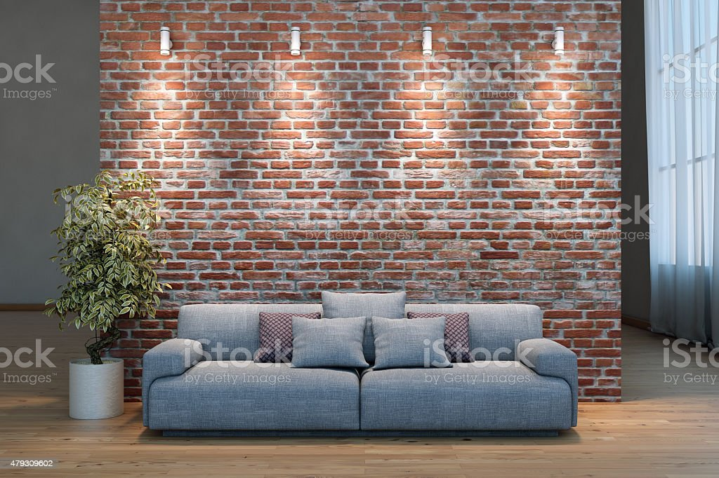 Emty wall with light and a sofa stock photo