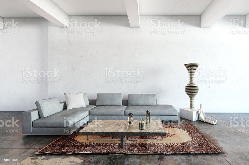 Emty wall with lots of light and a sofa stock photo
