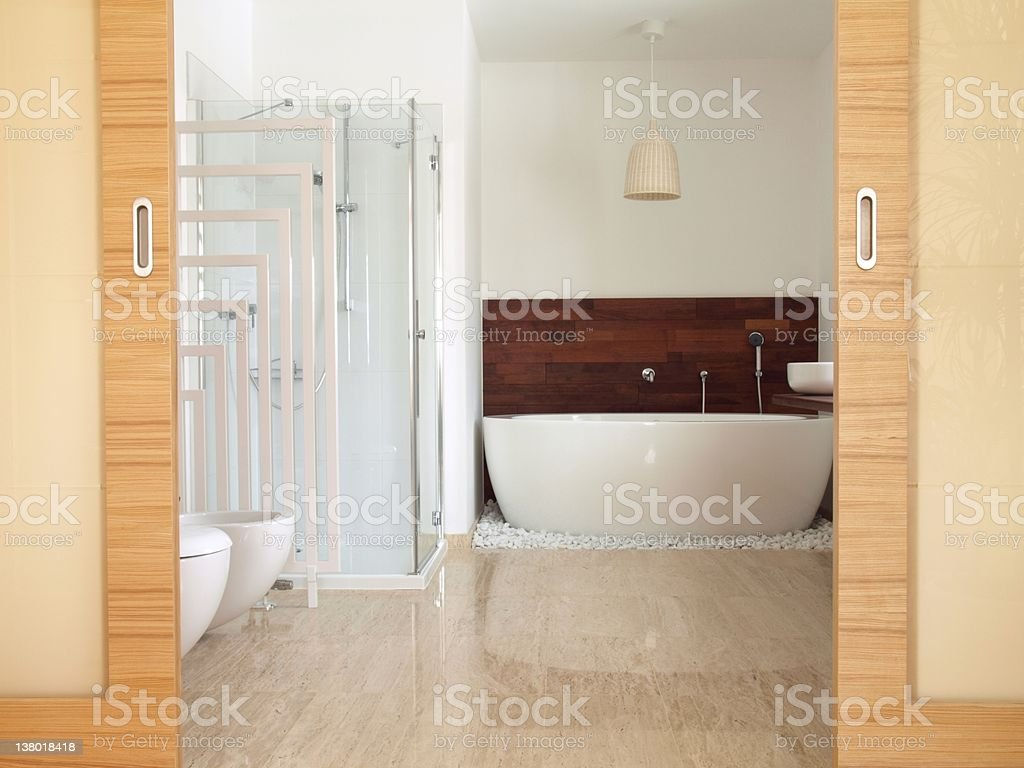 En suite bathroom with free standing bath royalty-free stock photo