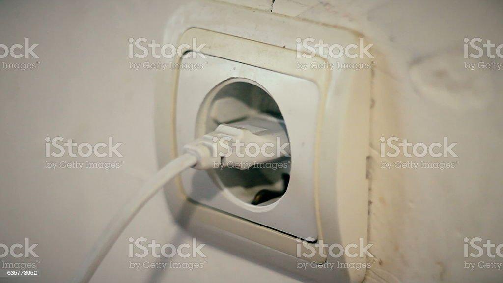 enabling,disabling man the plug stock photo
