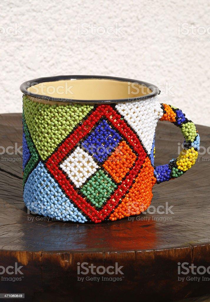 Enamel beaded coffee mug stock photo