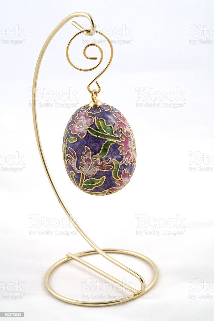 Enamel egg decoration hanging from metal stand royalty-free stock photo