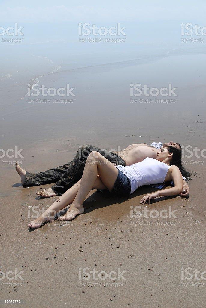 Enamoured on a beach stock photo