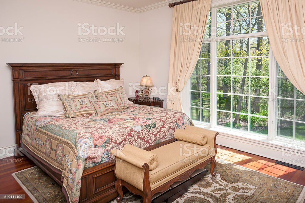 Enchanting master bedroom with amazing view of outdoors stock photo