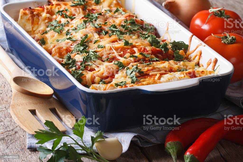 enchilada in baking dish closeup on the table. Horizontal stock photo