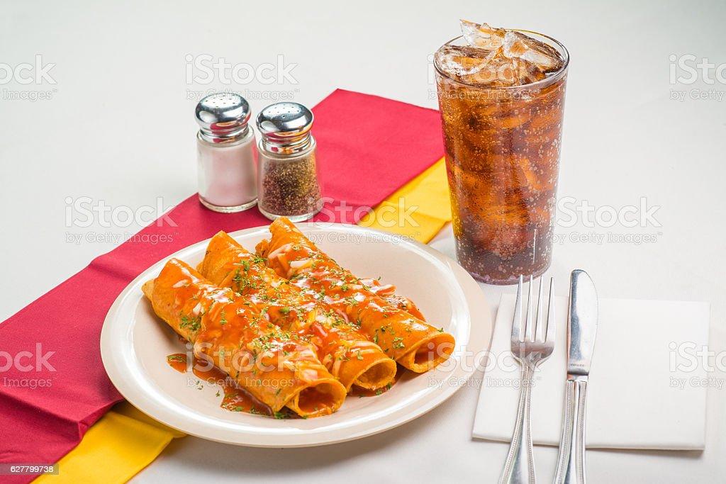 Enchiladas and Coke stock photo