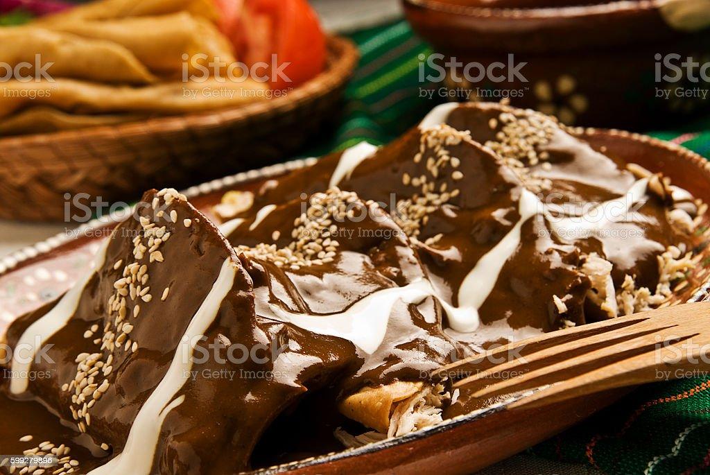 Enchiladas con mole stock photo