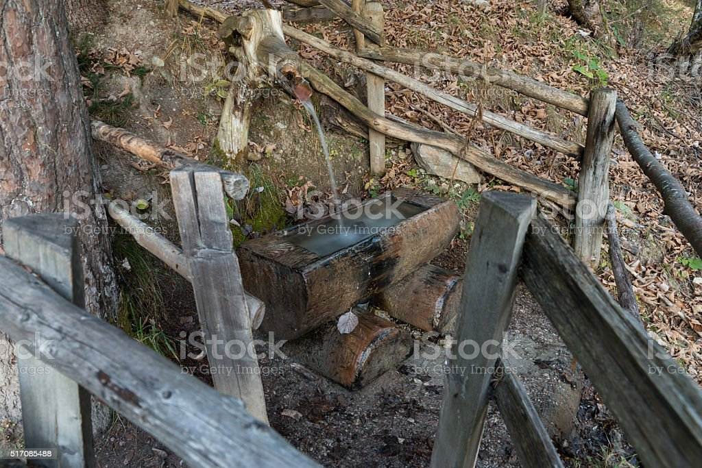 Enclosed water well at the edge of way stock photo