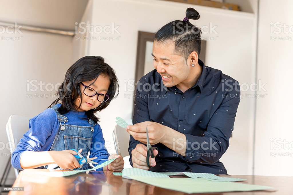 Encouraging child creativity stock photo