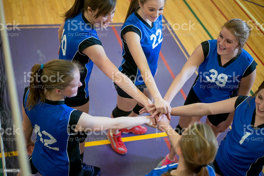 Encouraging Team Huddle During Volleyball Game stock photo