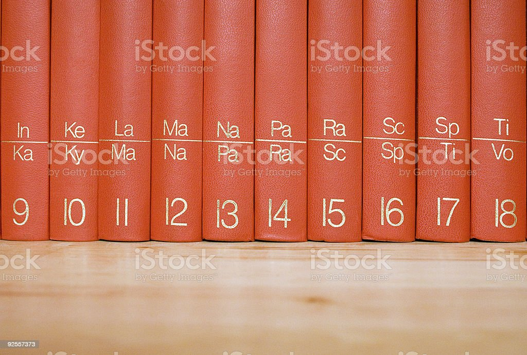 Encyclopedia in a Wooden Bookshelf royalty-free stock photo