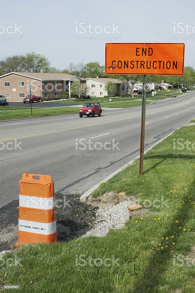 End Construction Sign & Street, Road Sign royalty-free stock photo