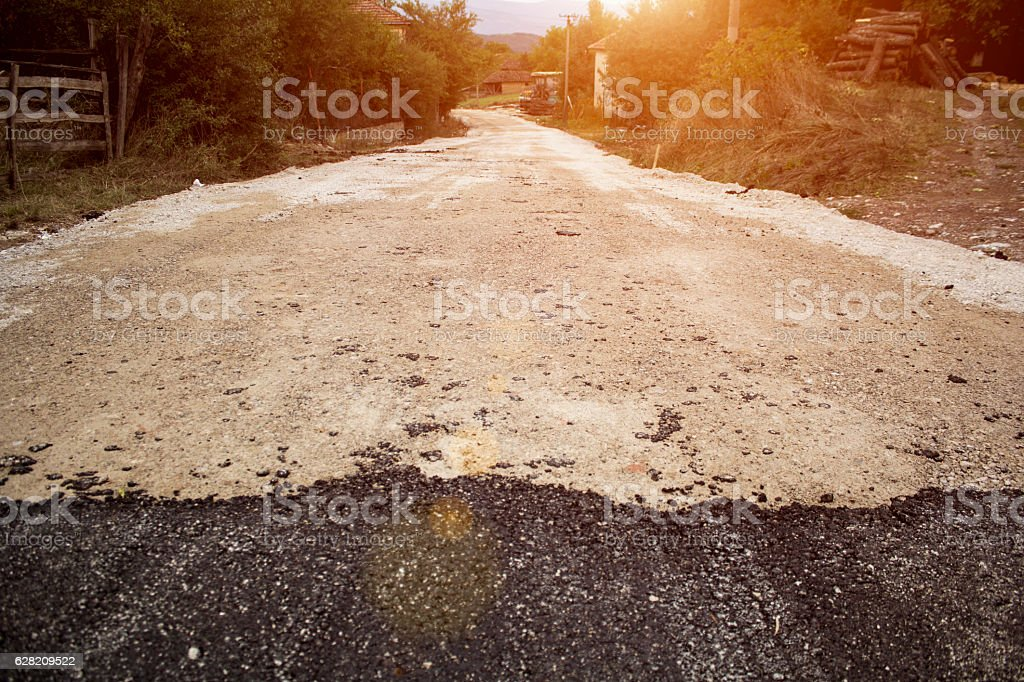End of an asphalt road. Unfinished road. stock photo