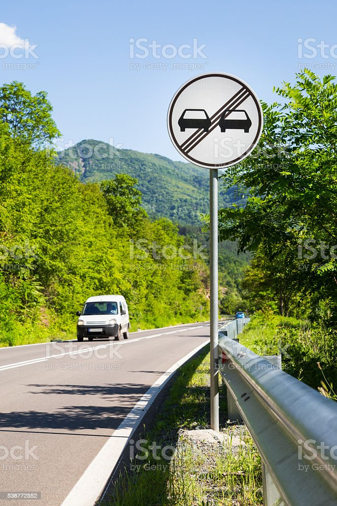 End of overtaking prohibition road traffic sign stock photo