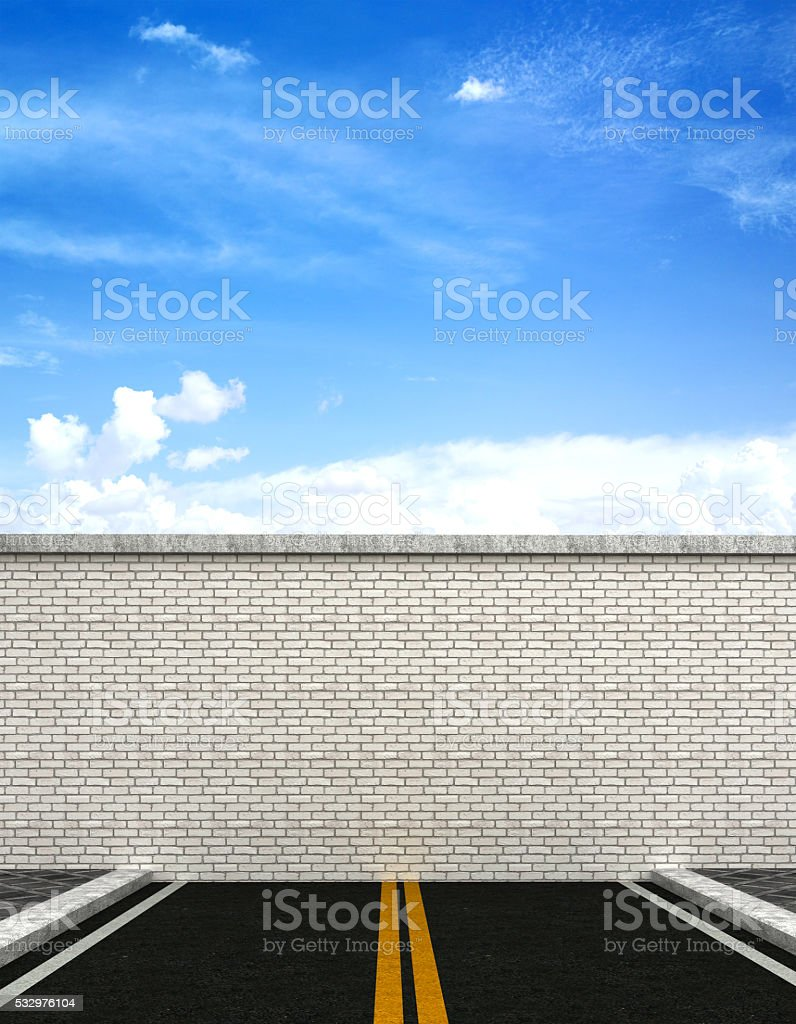 End of road concept with brick wall on highway stock photo