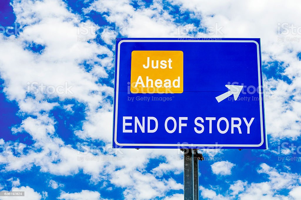 End Of Story Just Ahead Blue Road Sign Over Sky stock photo