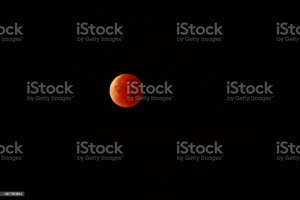 end of total lunar eclipse with first sunlight stock photo