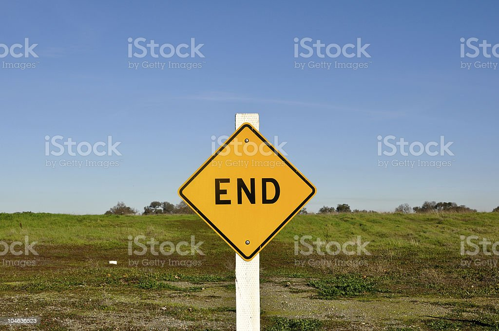 End Sign with Blue Sky Background royalty-free stock photo