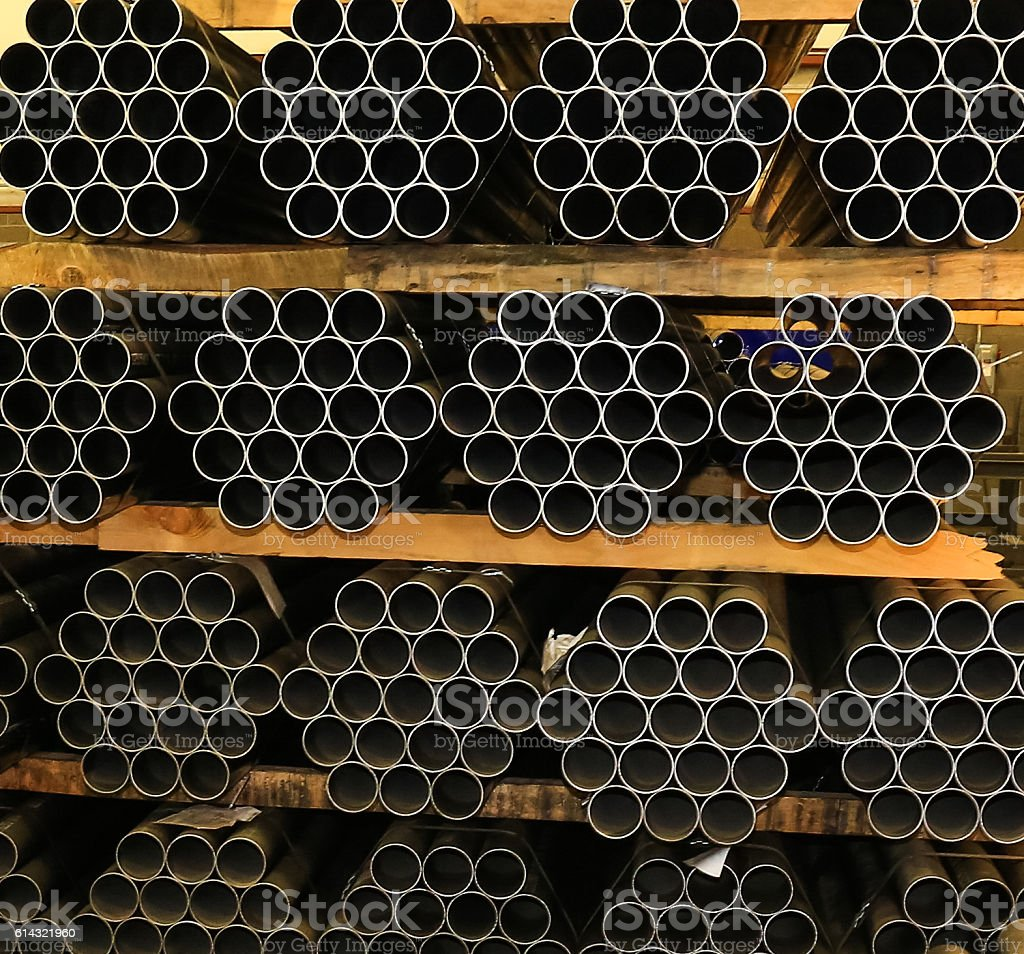 End view of stock pile of 3' pipe bundles, background stock photo