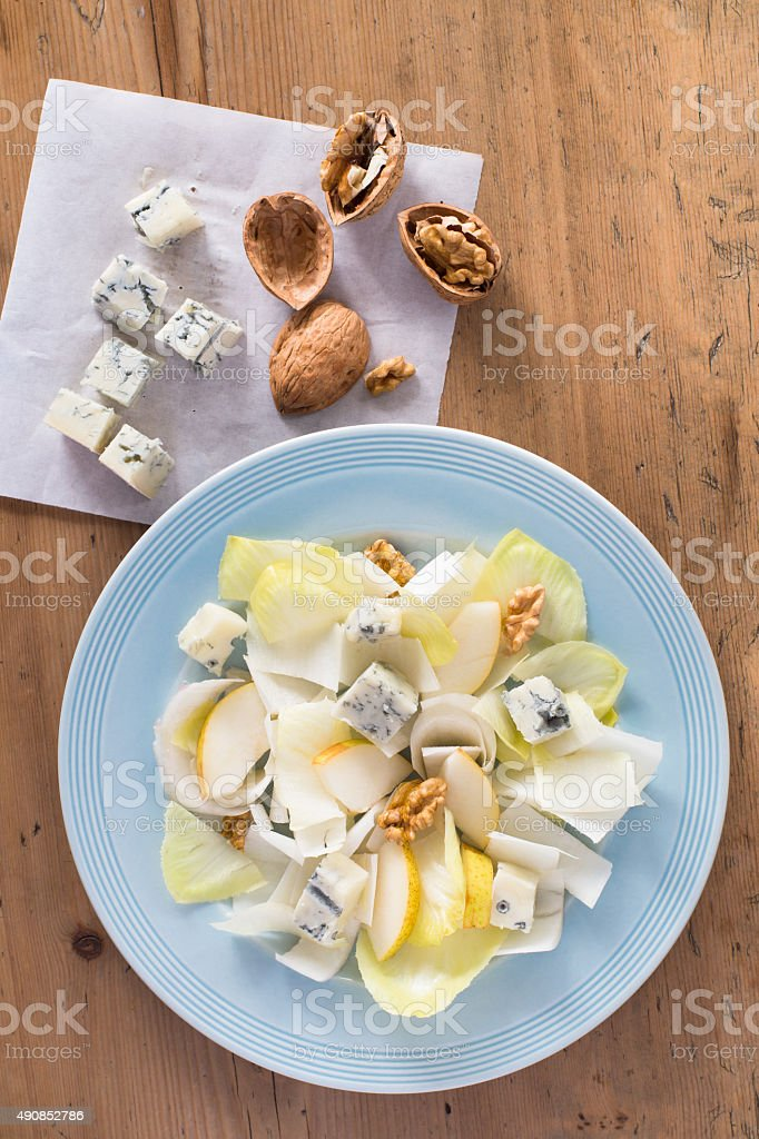 Endive salad with gorgonzola, pears and walnuts stock photo