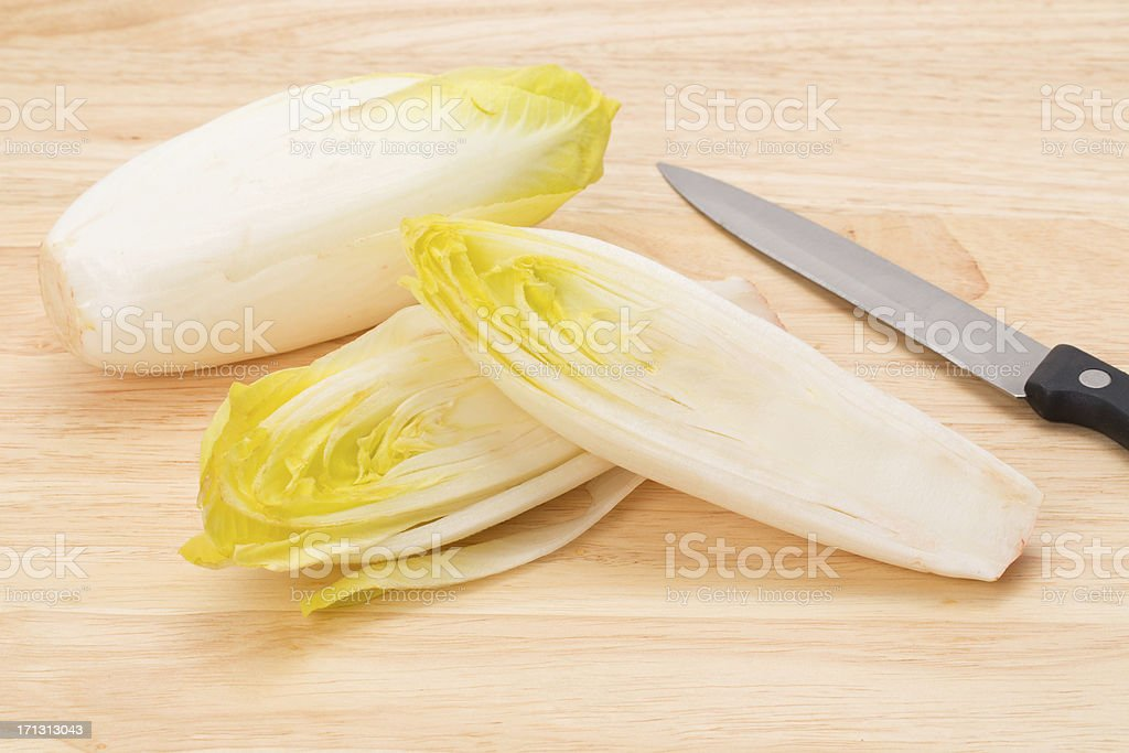 Endives on a wooden cutting board stock photo