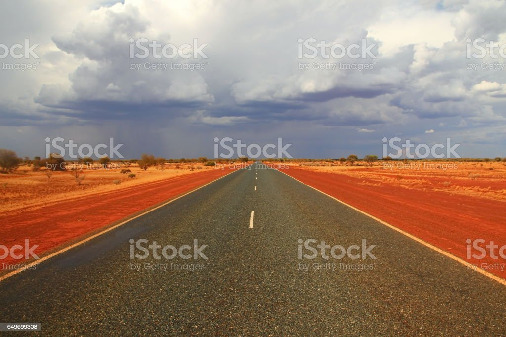 Endless Australian highway across the outback stock photo