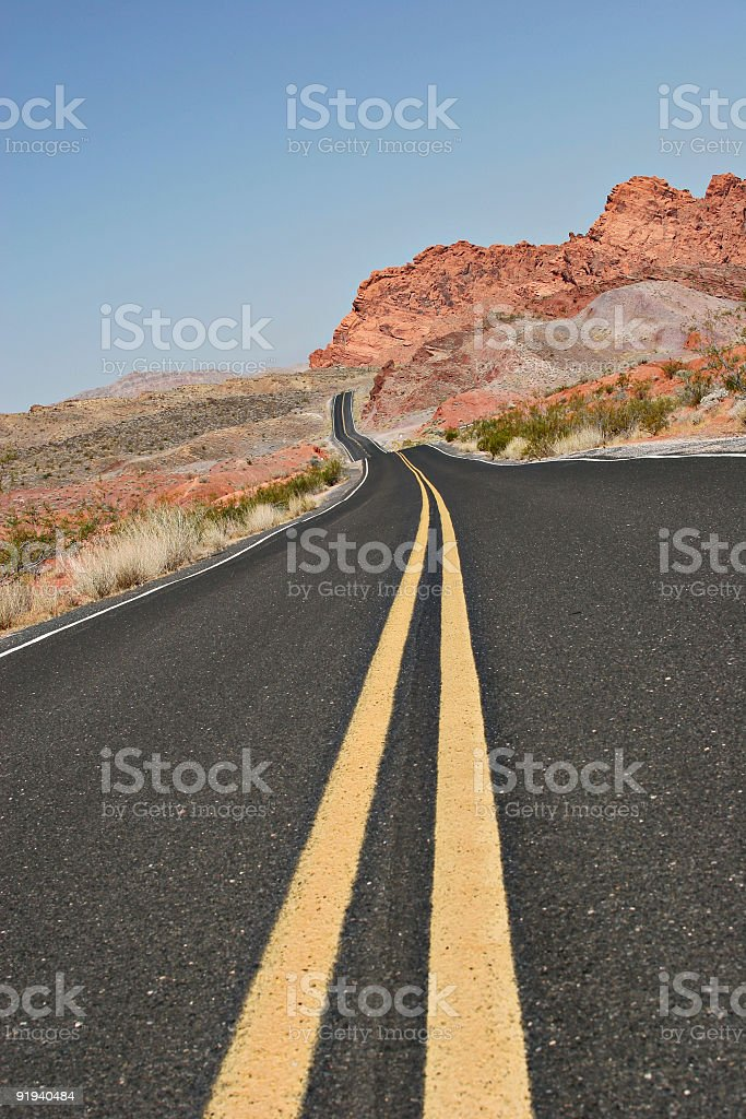 Endless curvy desert road royalty-free stock photo