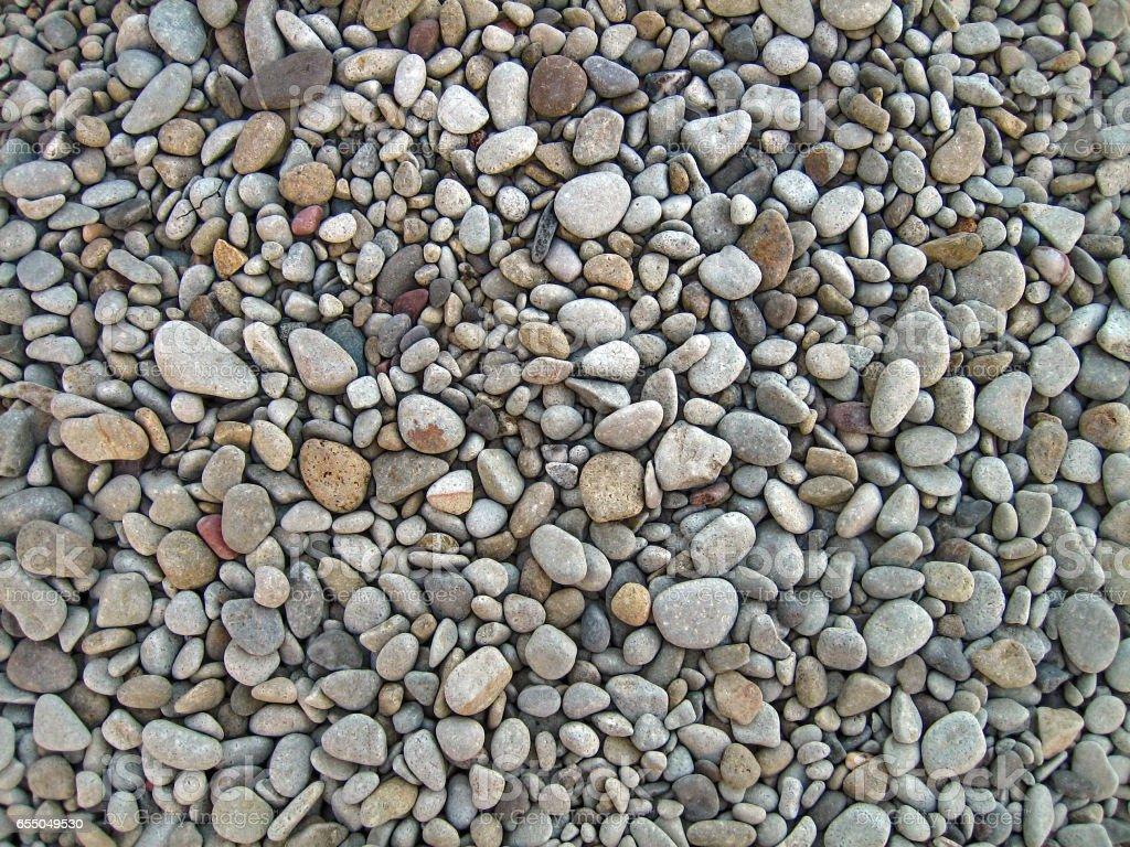 Endless dry sea pebbles, texture, background. stock photo