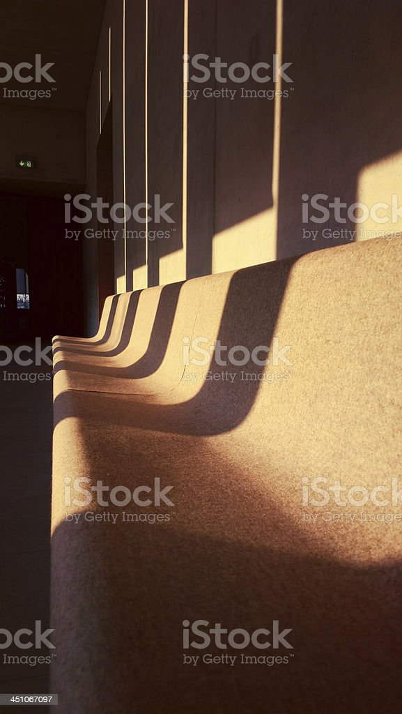 Endless felt bench in the last sunrays royalty-free stock photo