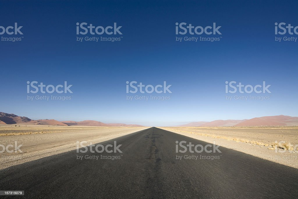 endless highway in the desert stock photo