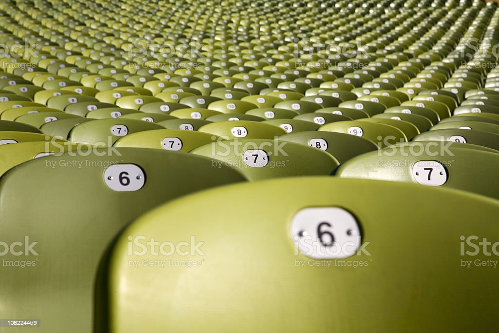 endless large group of seats - olymic soccer stadium munich stock photo