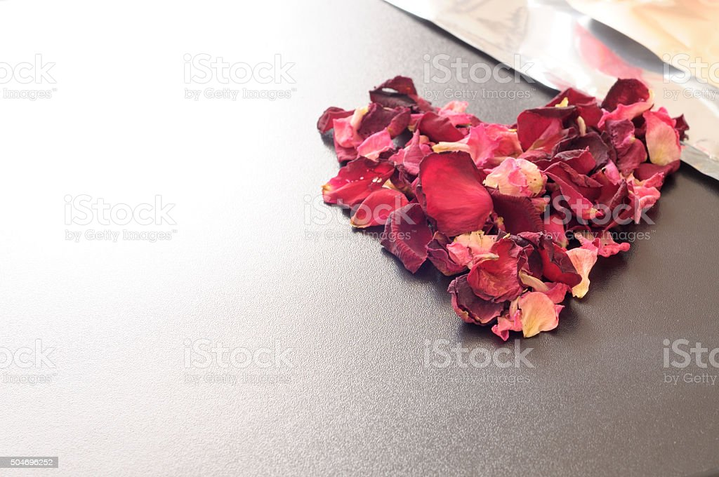endless love, heart shape made with rose petals stock photo