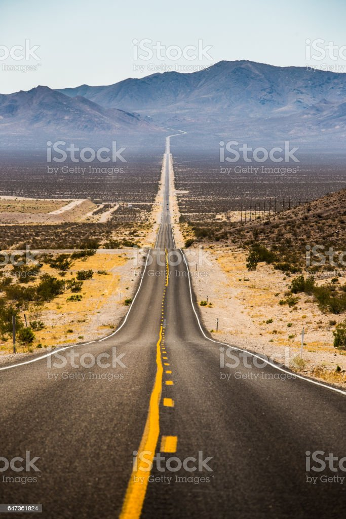 Endless straight road in Death Valley National Park, California, USA stock photo