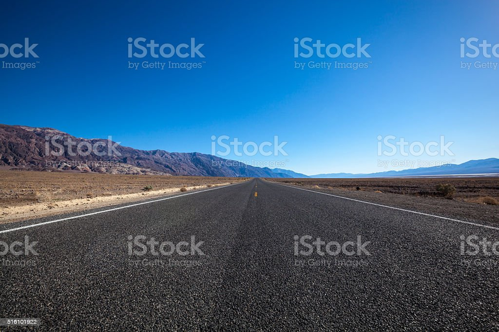 Endless straight road in Death Valley National Park stock photo