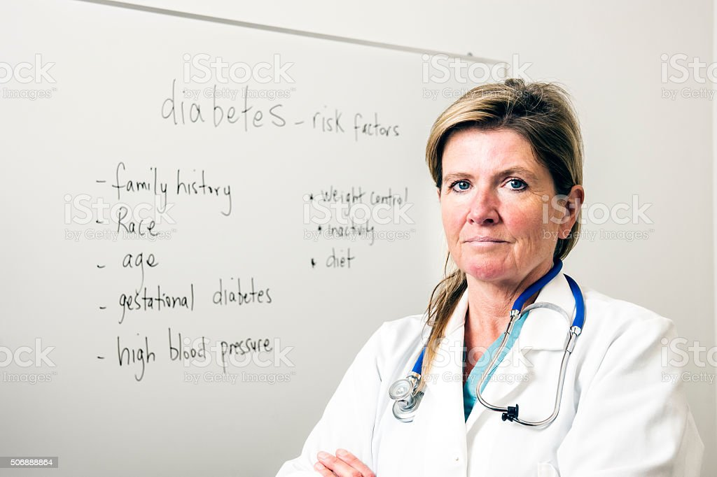 Endocrinologist or doctor with diabetes risk factors stock photo