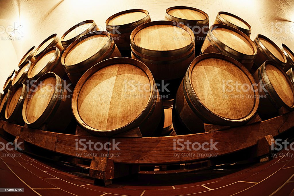 End-on view of stacked wine barrels, distorted by fish-eye lens royalty-free stock photo