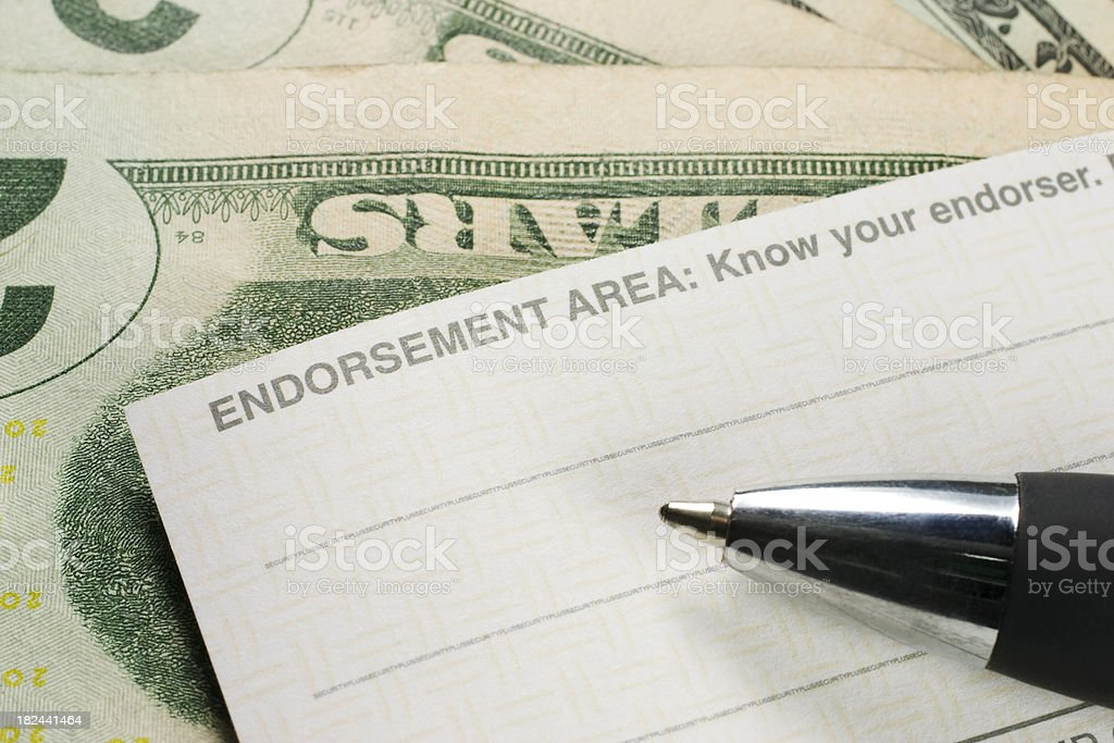 Endorsing the back of a check stock photo