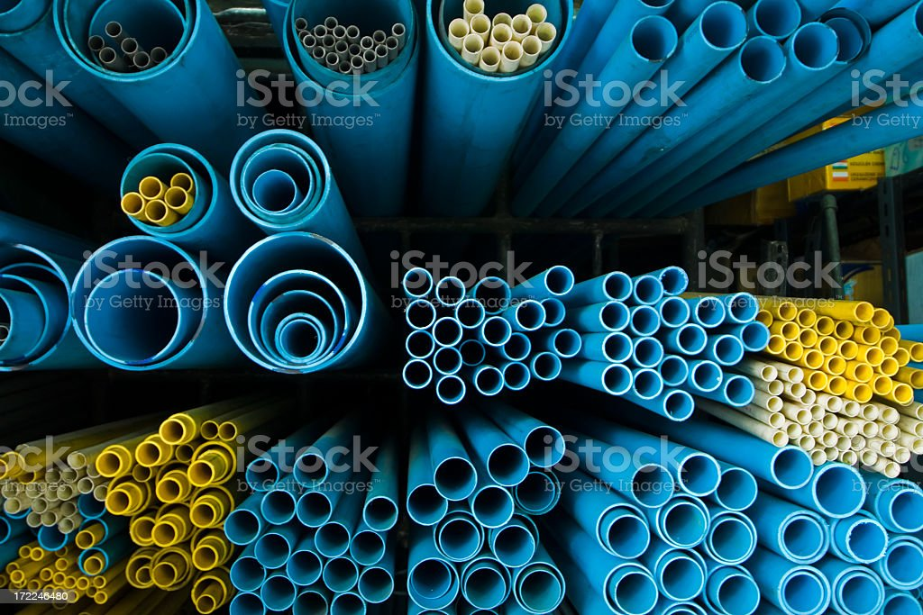 End-view of groups of different sized blue and yellow tubes stock photo