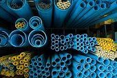 End-view of groups of different sized blue and yellow tubes