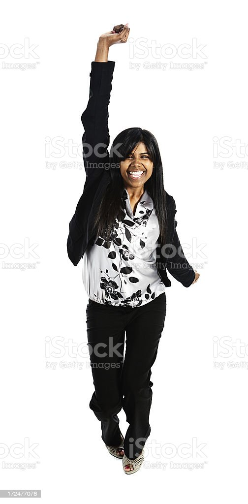 Energetic and enthusiastic young woman jumps for joy royalty-free stock photo