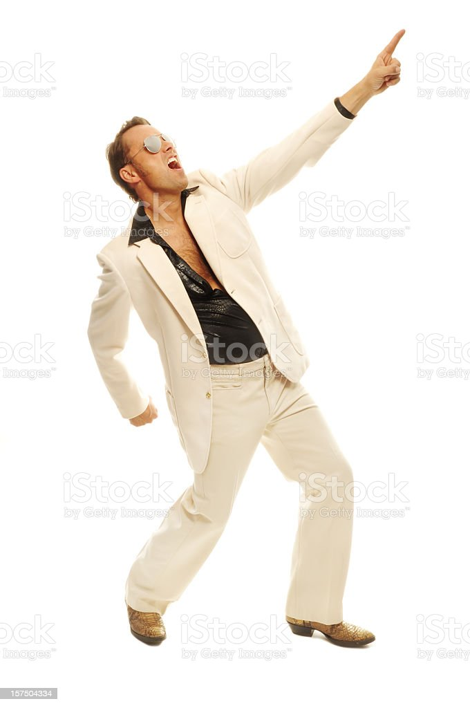 Energetic disco dancer in white suit with snakeskin boots royalty-free stock photo