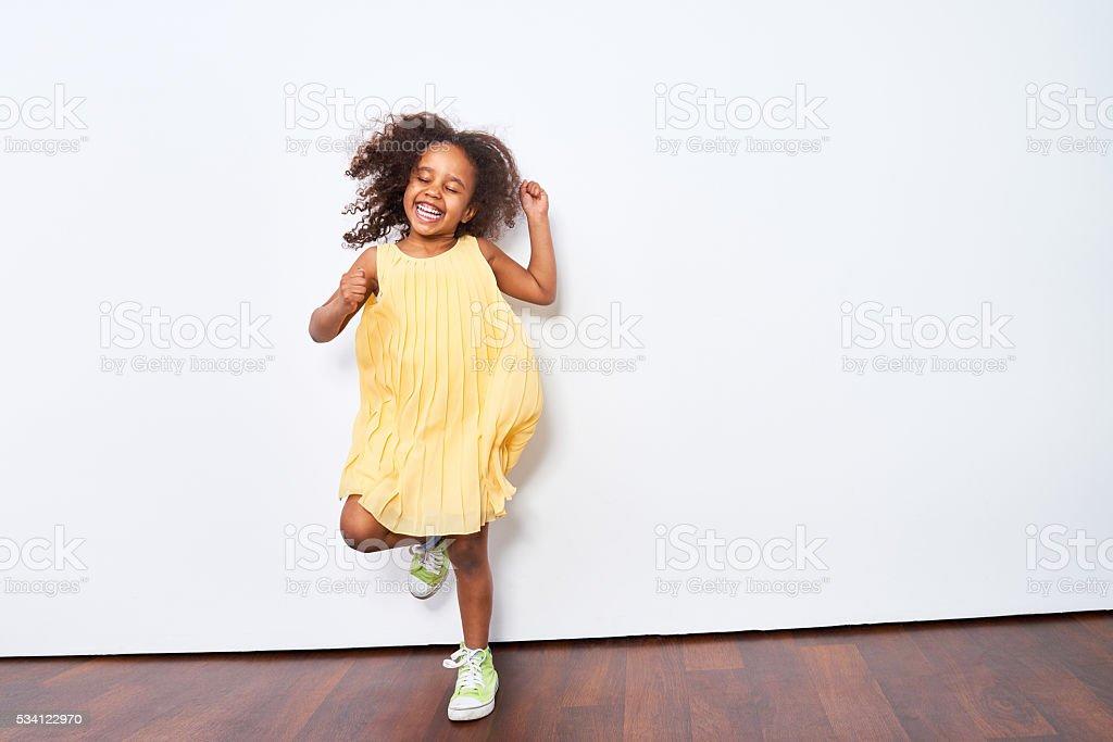 Energetic little dancer stock photo
