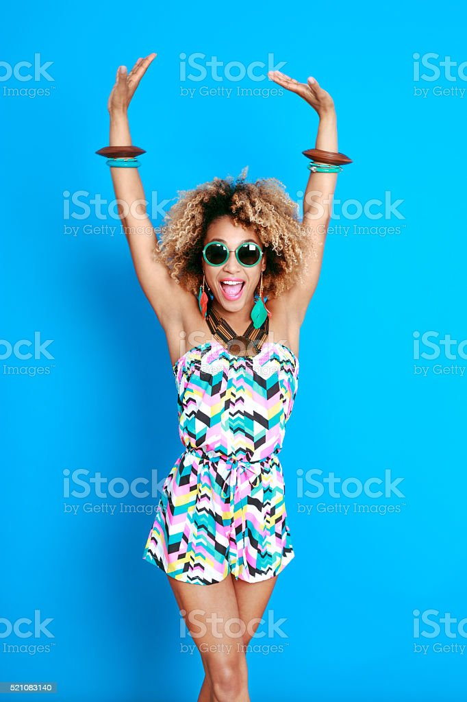 Energetic summer afro young woman stock photo