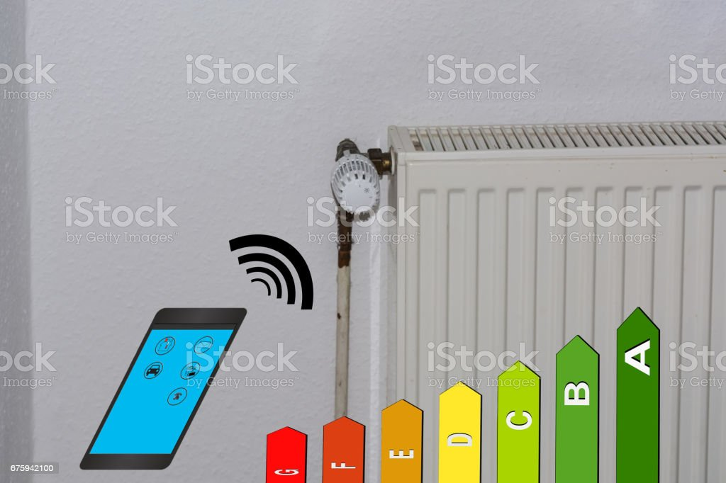 Energy efficiency class symbol, radiator and smartphone. stock photo