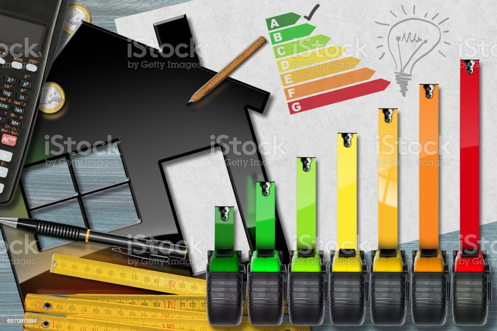 Energy Efficiency Rating with Calculator and House stock photo