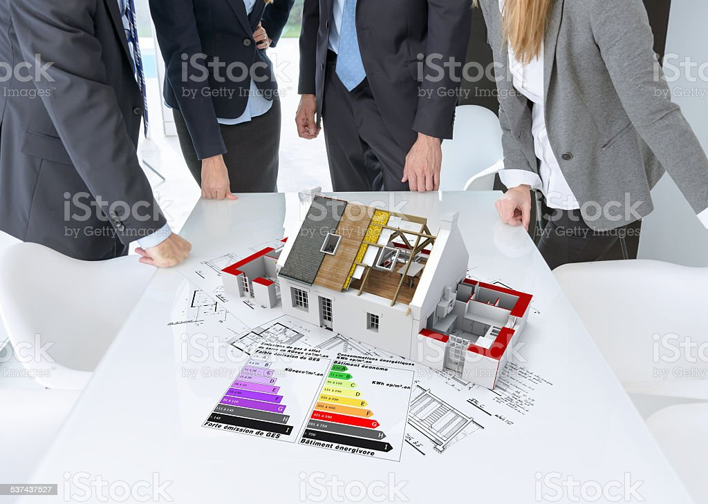 Energy efficient construction meeting stock photo