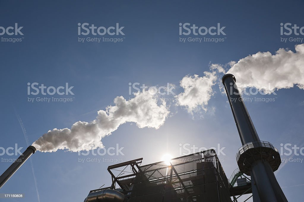 energy from waste - incinerator chimneys stock photo