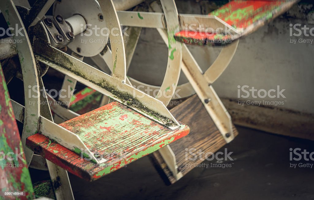 Energy of water. Old-fashioned watermill stock photo