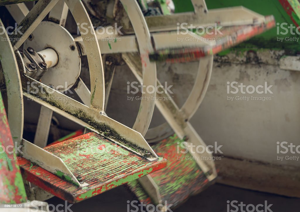 Energy of water. Wheel of obsolete water mill stock photo