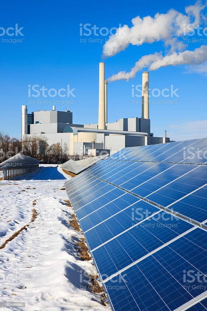 Energy - rack of solar panels and thermal power plant royalty-free stock photo